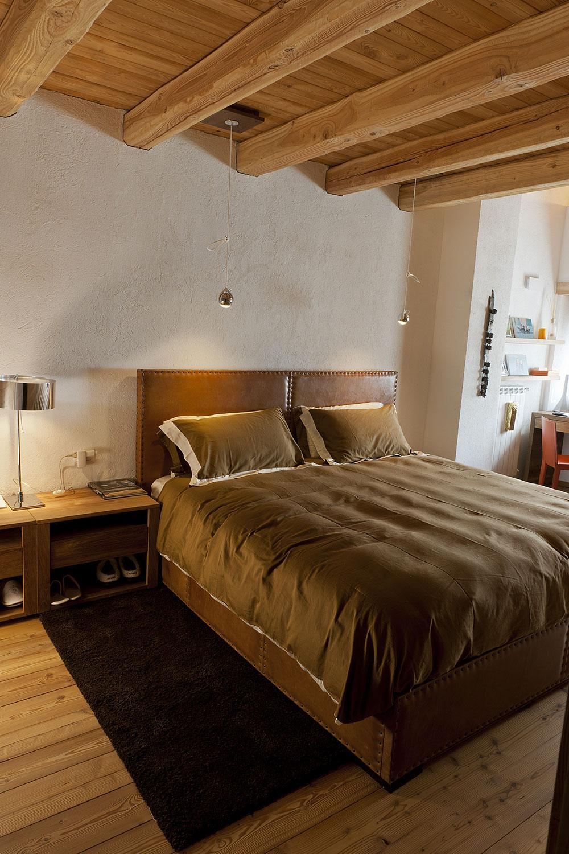 Arredamento montagna moderno legno pietra e resina nello for Arredare gli interni di una casa
